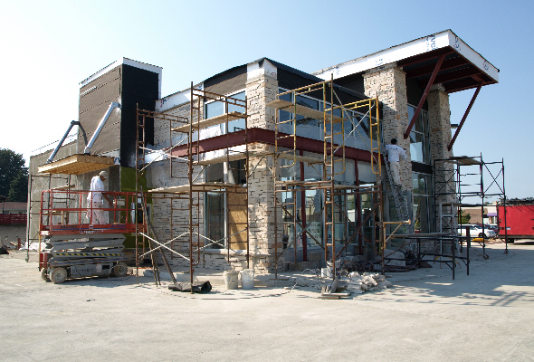 An exterior of a local bank under construction. Commercial industrial painting